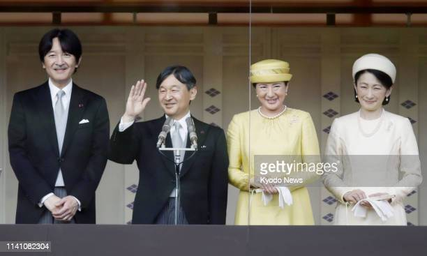 Japanese Emperor Naruhito waves to wellwishers gathered at the Imperial Palace in Tokyo on May 4 in his first public appearance since his...