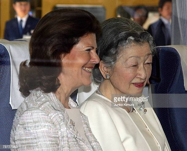Japanese Empress Michiko and Swedish Queen Silvia smile on the train at Seibu Railway Shinjuku Station on March 28 2007 in Tokyo Japan The Swedish...