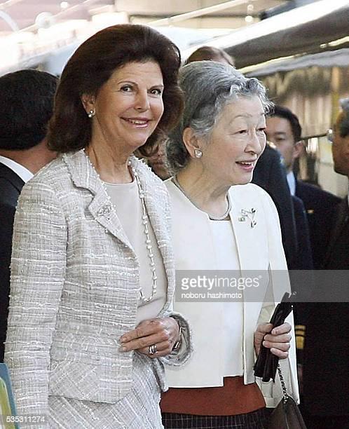 Japanese Empress Michiko and Swedish Queen Silvia walk along the platform at Seibu Railway Shinjuku Station in Tokyo The Swedish King and Queen and...