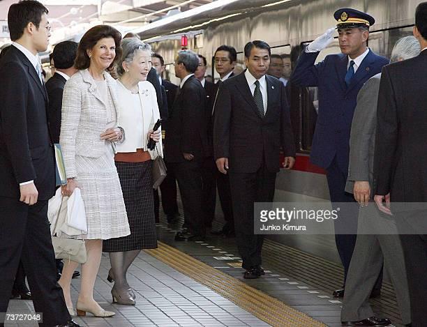 Japanese Empress Michiko and Swedish Queen Silvia walk at the platform at Seibu Railway Shinjuku Station on March 28 2007 in Tokyo Japan The Swedish...