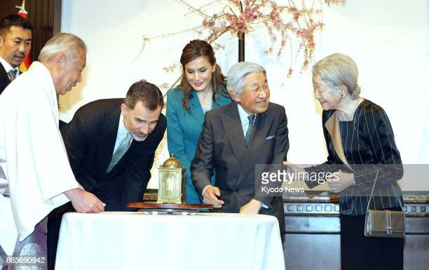 Japanese Empress Michiko Emperor Akihito Spanish Queen Letizia and King Felipe VI look at a clock made in Madrid in 1581 and presented in the early...