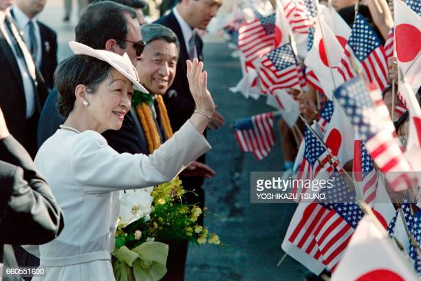 Japanese Empress Michiko waves to wellwishers as she arrives at Hickam Air Force Base in Honolulu on June 23 1994 as Japanese Emperor Akihito...