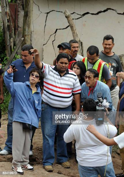Japanese engineers conduct a survey on October 24 2008 on a heavily damaged sector of El Eden neighborhood on the side of El Picacho hill in...