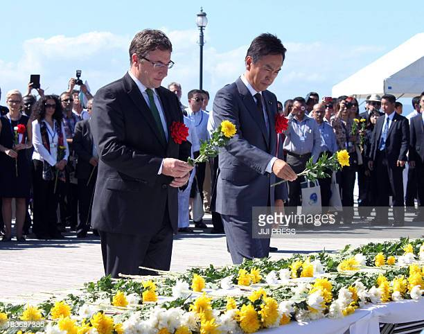 Japanese Environment Minister Nobuteru Ishihara and Achim Steiner United Nations Environment Programme Executive Director lays chrysanthemum on the...