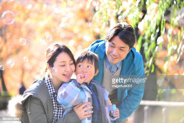 Japanese Family Blowing Soap Bubbles in Ueno Park, Tokyo