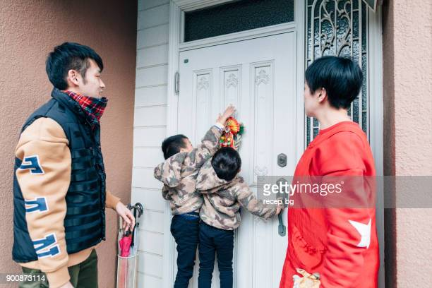 japanese family decorating house for new year - 2 5 months stock pictures, royalty-free photos & images