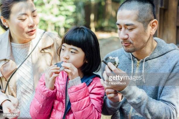 japanese family eating onigiri together - rice ball stock pictures, royalty-free photos & images