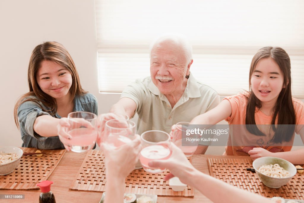 Japanese family eating together : Stock Photo