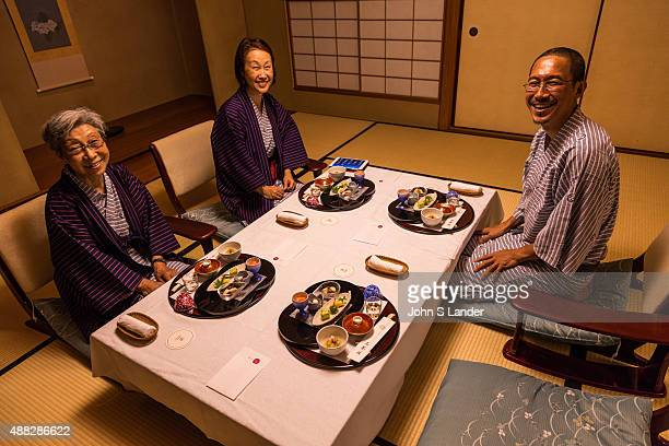 Japanese family enjoying Kaiseki - a traditional Japanese dinner served in a series of courses. Kaiseki draws on a number of traditional Japanese...