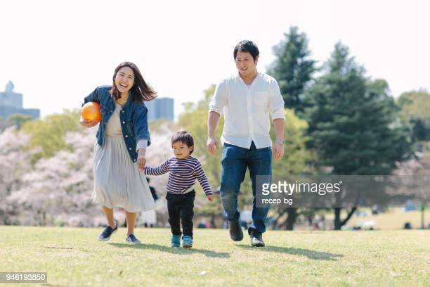 japanese family enjoying their time in spring - east asian culture stock photos and pictures