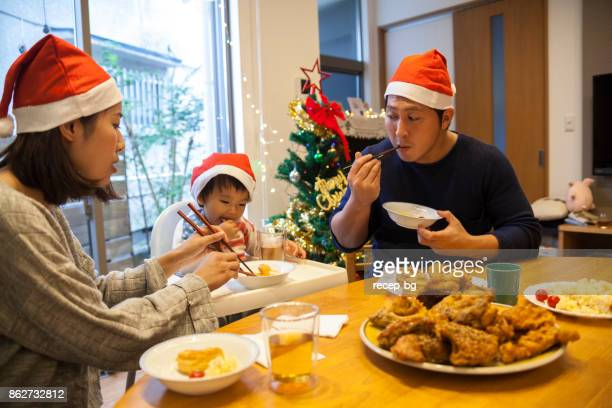japanese family having christmas lunch - fried chicken stock photos and pictures