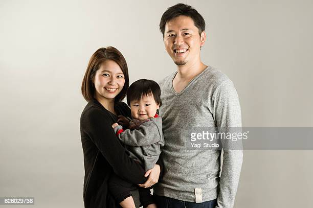 japanese family  in studio shot - three people ストックフォトと画像