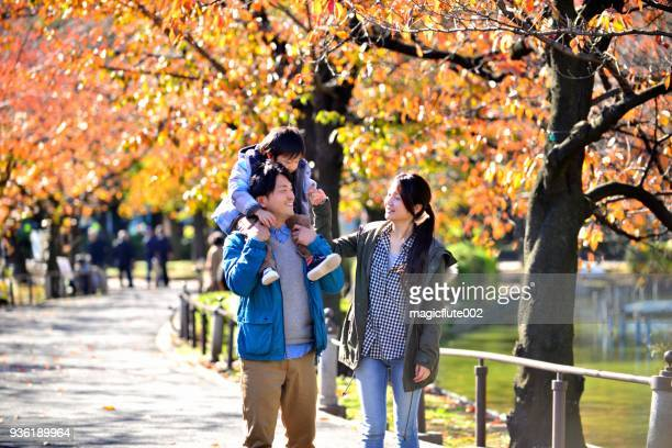 Japanese Family Relaxing in Ueno Park, Tokyo