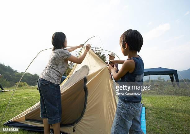 Japanese famliy preparing a camping tent
