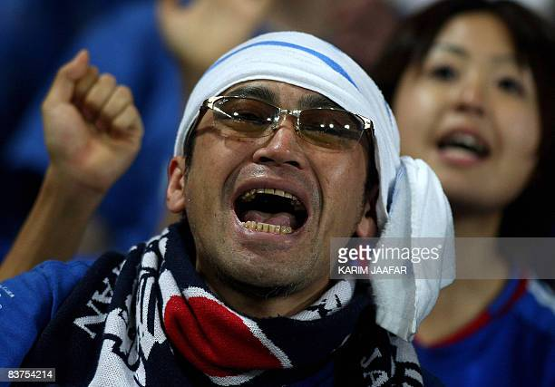 A Japanese fan celebrates after his team beat Qatar in their Asian zone Group 1 World Cup qualifying football match in Doha on November 19 2008...
