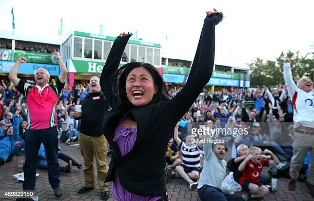 Japanese fan celebrates as the big screen shows Japan defeating South Africa during the 2015 Rugby World Cup Pool D match between France and Italy at...