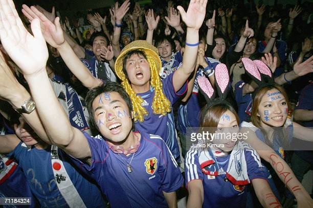 Japanese fan cheer during the public viewing of the FIFA World Cup Germany 2006 Group F match between Australia and Japan at Nakatanet cafe on June...