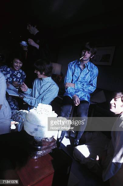 A Japanese fan Paul McCartney standing George Harrison Ringo Starr and John Lennon in their hotel suite at the Tokyo Hilton during the band's tour of...