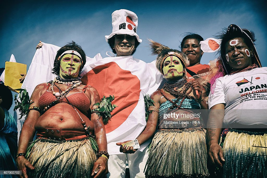 A Japanese fan poses with two local tribes women during the FIFA U-20 Women's World Cup Papua New Guinea 2016 Third Place Play Off match between USA and Japan at the National Football Stadium on December 3, 2016 in Port Moresby, Papua New Guinea.