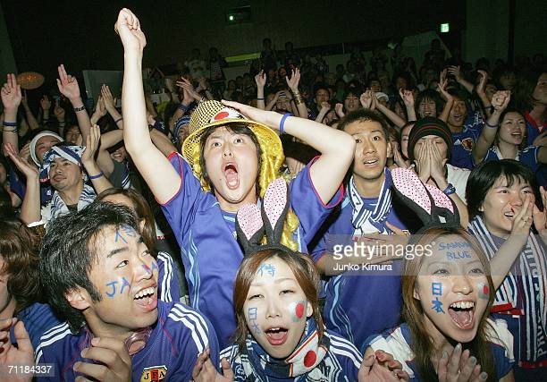 Japanese fan react during the public viewing of the FIFA World Cup Germany 2006 Group F match between Australia and Japan at Nakatanet cafe on June...