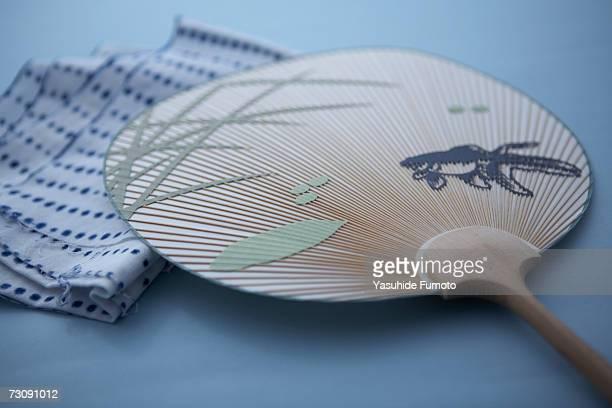 japanese fan, uchiwa and hand towel, tenugui, close-up - 手ぬぐい ストックフォトと画像