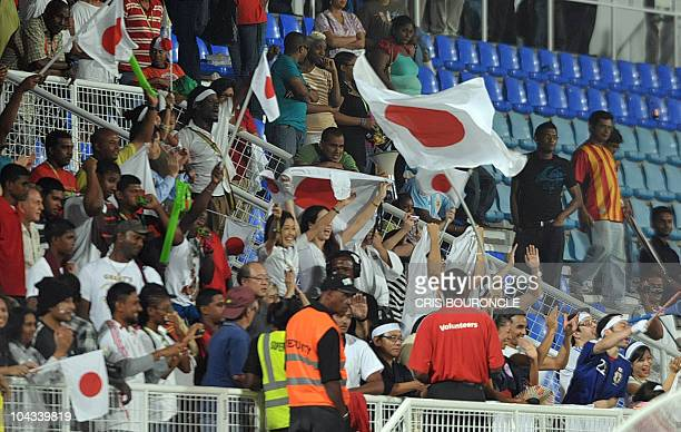 Japanese fans celebrate after winning by 21 in their FIFA Women's Under17 semifinal match against North Korea on September 21 at the Ato Boldon...