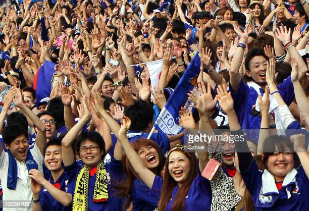 Japanese fans cheer as Japan score a goal as they watch the 2010 FIFA World Cup match between Japan and Denmark at Saitama Stadium on June 25 2010 in...
