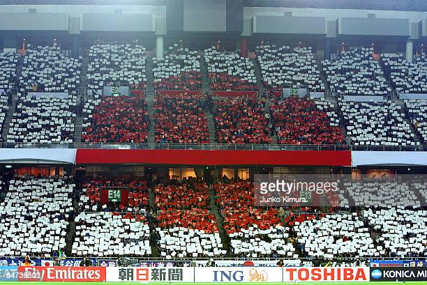 Japanese fans cheer during the 2010 FIFA World Cup Asian qualifying match between Japan and Australia at Nissan Stadium on February 11 2009 in...