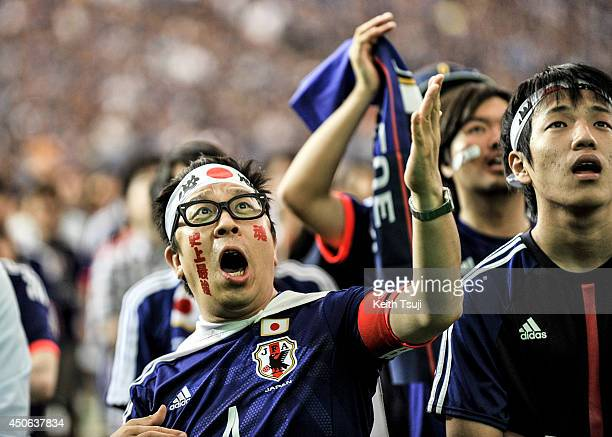 Japanese fans cheer on their team during the 2014 FIFA World Cup between Japan and Cote d'Ivoire during the public viewing event at Tokyo Dome on...