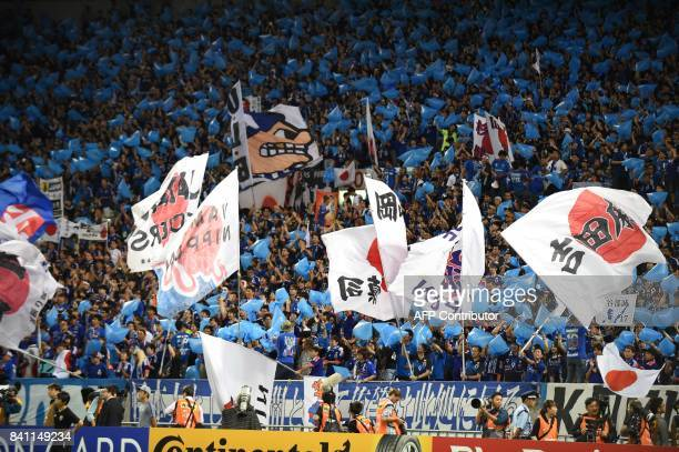 Japanese fans cheer on their team prior to the group B World Cup 2018 qualifying football match between Japan and Australia in Saitama on August 31...