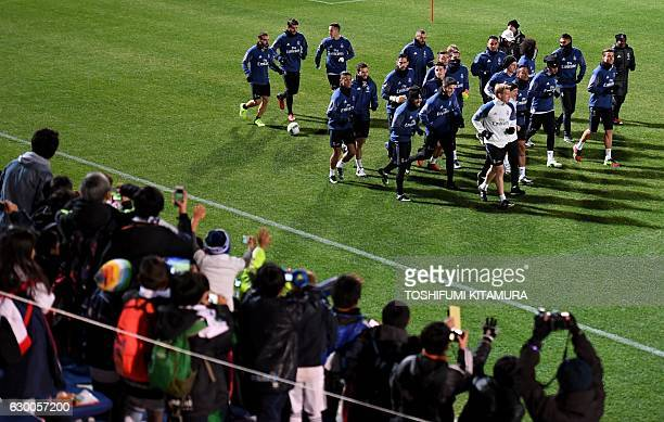Japanese fans cheer Real Madrid players during a training session at Mitsuzawa stadium in Yokohama on December 16 ahead of their Club World Cup...