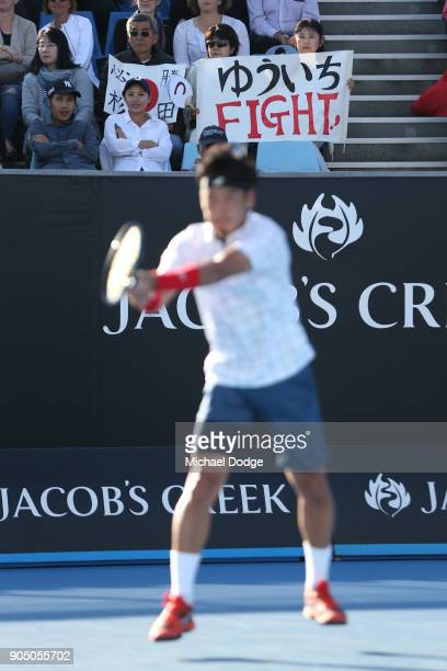 Japanese fans cheer Yuichi Sugita of Japan during his first round match against Jack Sock of the United States on day one of the 2018 Australian Open...