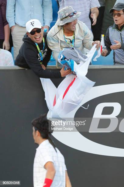 Japanese fans congratulate Yuichi Sugita of Japan after he won his first round match against Jack Sock of the United States on day one of the 2018...