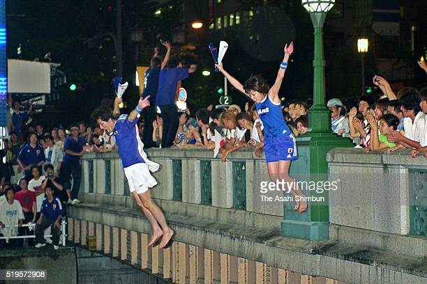 Japanese fans dive in the Dotonbori River to celebrate Japan's win and going through to the knock out stage after the FIFA World Cup Korea/Japan...