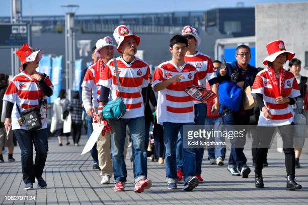 Japanese fans make their way to the stadium prior to the test match between Japan and New Zealand All Blacks at Tokyo Stadium on November 03 2018 in...