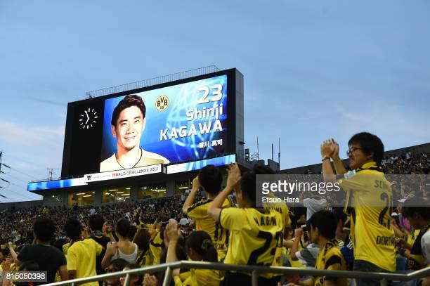 Japanese fans of Borussia Dortmund cheer prior to the preseason friendly match between Urawa Red Diamonds and Borussia Dortmund at Saitama Stadium on...