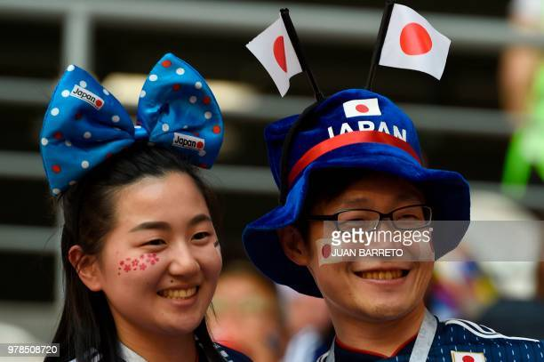 Japanese fans pose before the Russia 2018 World Cup Group H football match between Colombia and Japan at the Mordovia Arena in Saransk on June 19,...