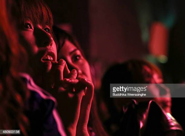Japanese fans react as they watch the live broadcast of the 2014 FIFA World Cup match between Japan and Greece during the public viewing event at the...