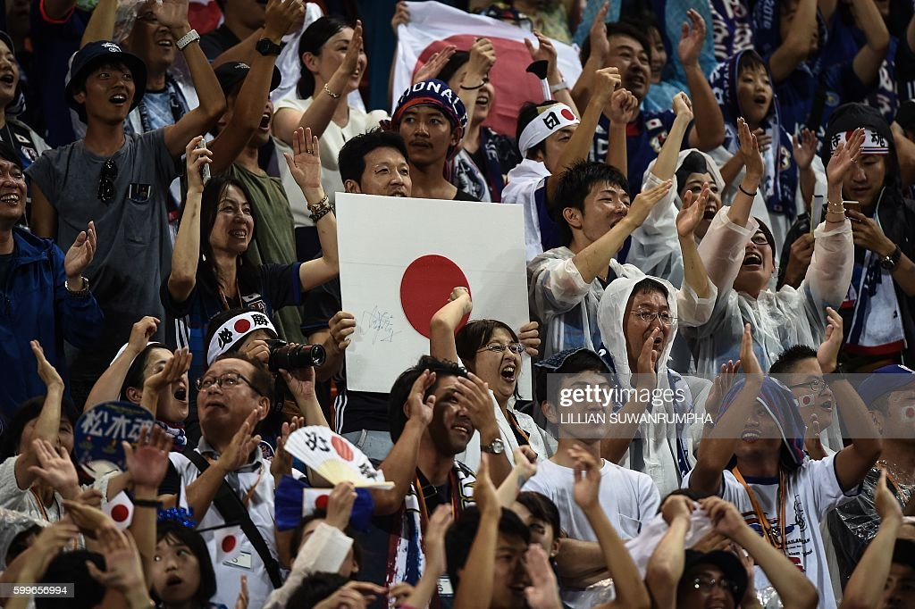 Japanese fans rejoice after Genki Haraguchi scored the first goal in Japan's 2-0 victory over Thailand during the 2018 FIFA World Cup qualifying football match between Thailand and Japan in Bangkok on September 6, 2016. / AFP / LILLIAN