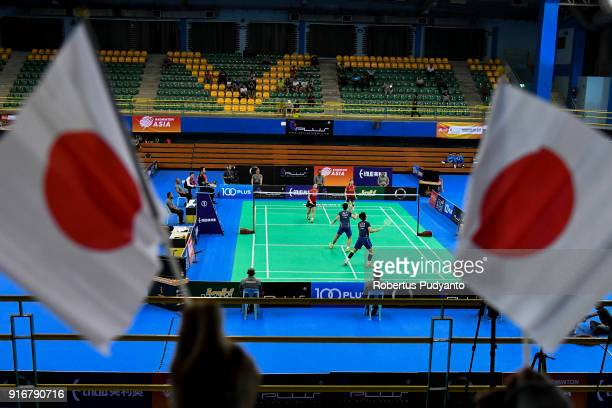 Japanese fans rise flag during the game between Misaki Matsutomo and Ayaka Takahashi of Japan against Du Yue and Lin Yinhui of China in the Women's...