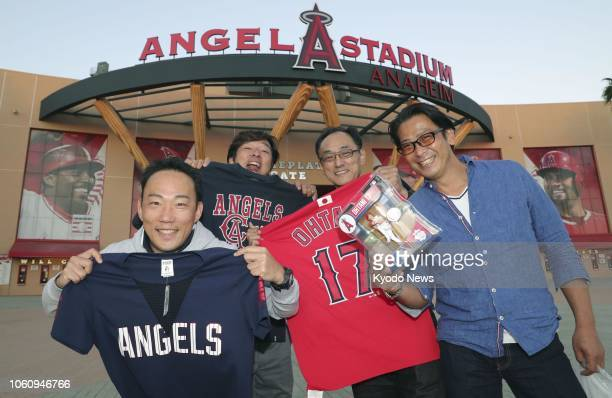 Japanese fans show Los Angeles Angels merchandise in Anaheim California on Nov 12 after Shohei Ohtani of the team was named Major League Baseball...