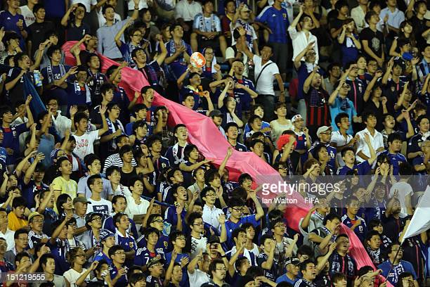 Japanese fans show their support during the FIFA U20 Women's World Cup SemiFinal match between Japan and Germany at the National Stadium on September...