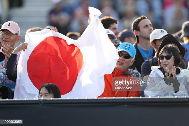 Japanese fans show their support during the Men's Singles first round match between Yuichi Sugita of Japan and Elliot Benchetrit of France on day two...