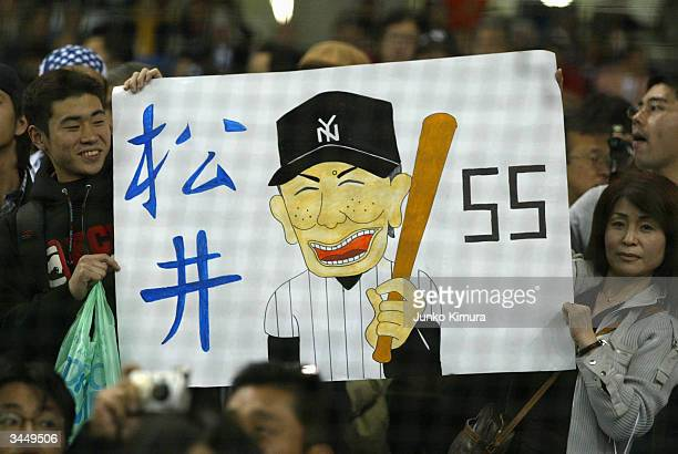 Japanese fans support Japan's own Hideki Matsui of the New York Yankees during the game against the Tampa Bay Devil Rays at the Tokyo Dome on March...
