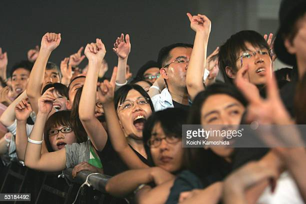 """Japanese fans watch DREAMS COME TRUE performs on stage during """"Live 8 Japan"""" at Makuhari Messe on July 2, 2005 in Chiba, east of Tokyo, Japan. The..."""