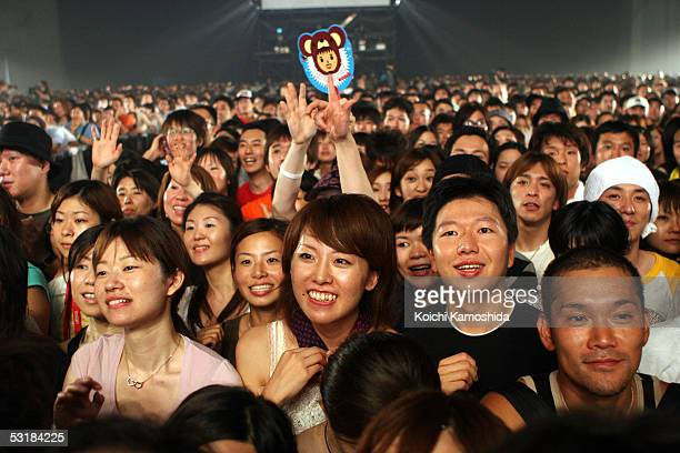 """Japanese fans watch the Dreams Come True perform on stage during """"Live 8 Japan"""" at Makuhari Messe on July 2, 2005 in Chiba, east of Tokyo, Japan. The..."""