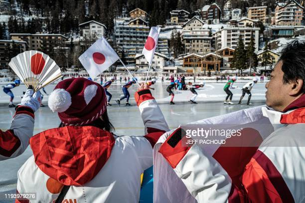 Japanese fans watch the Speed Skating womens Mass Start event on the St. Moritz Speed Skating Oval at St. Moritz, in Lausanne, during the 2020...