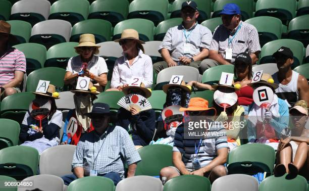 Japanese fans watch the women's singles third round match between Thailand's Luksika Kumkhum and Croatia's Petra Martic on day five of the Australian...