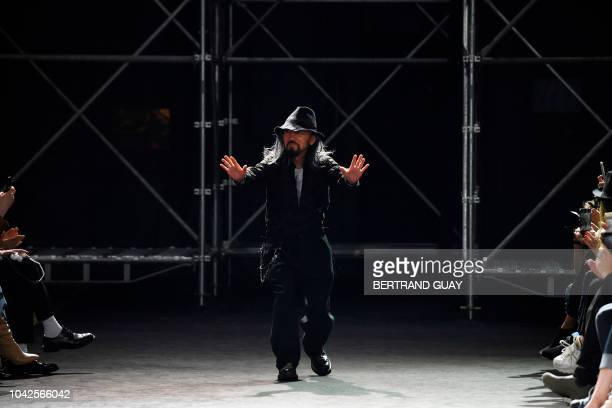 Japanese fashion desgner Yohji Yamamoto acknowledges the audience at the end of the Yohji Yamamoto Spring-Summer 2019 Ready-to-Wear collection...