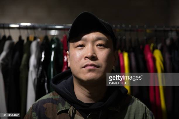 Japanese fashion designer and former boxer Arashi Yanagawa poses for a picture at a fashion studio in east London on January 6 2017 After making the...
